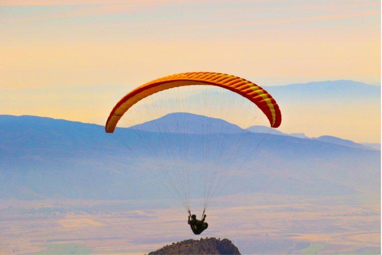 person riding parachute