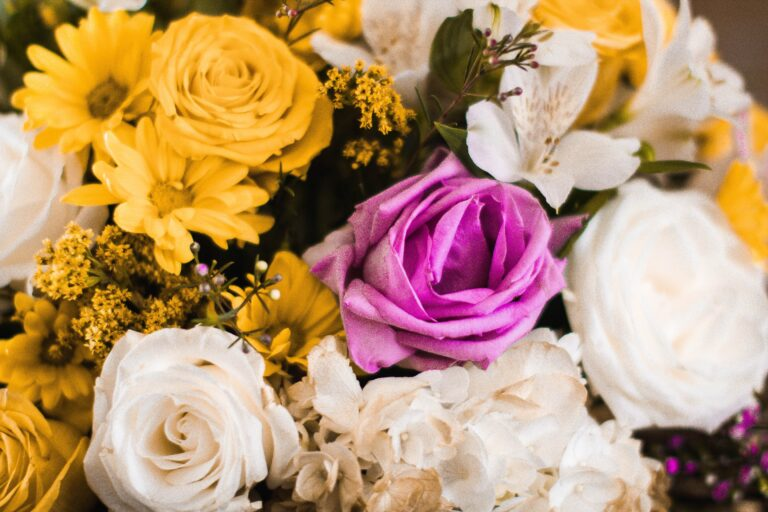yellow, white, and purple flower arrangment